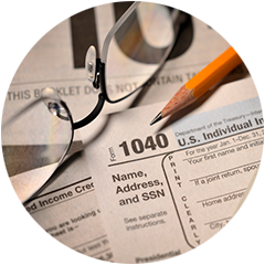 Lakeville Accountants | Form 1040 with pencil and glasses